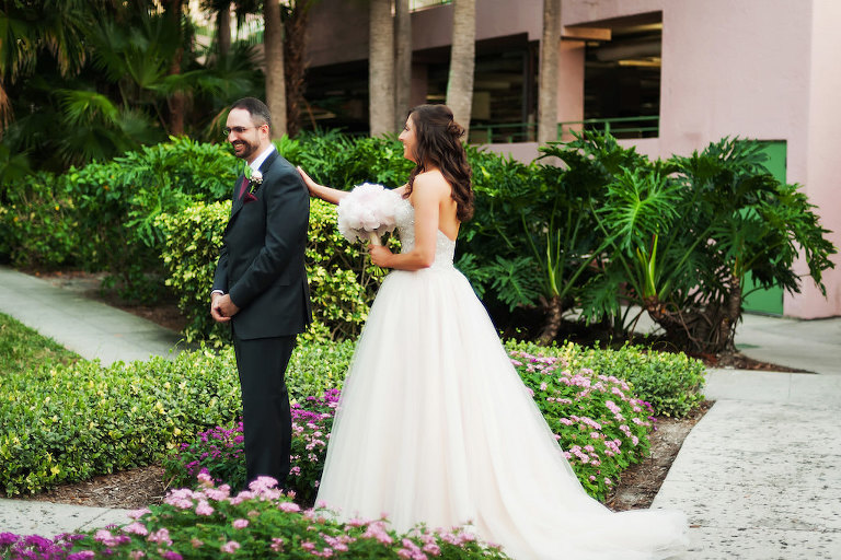 Blush Pink Sweetheart Wedding Dress with Lace and Rhinestones and Blush Pink Peonies Bouquet Bride and Groom's First Look | Tampa Bay Bridal Shop Truly Forever Bridal