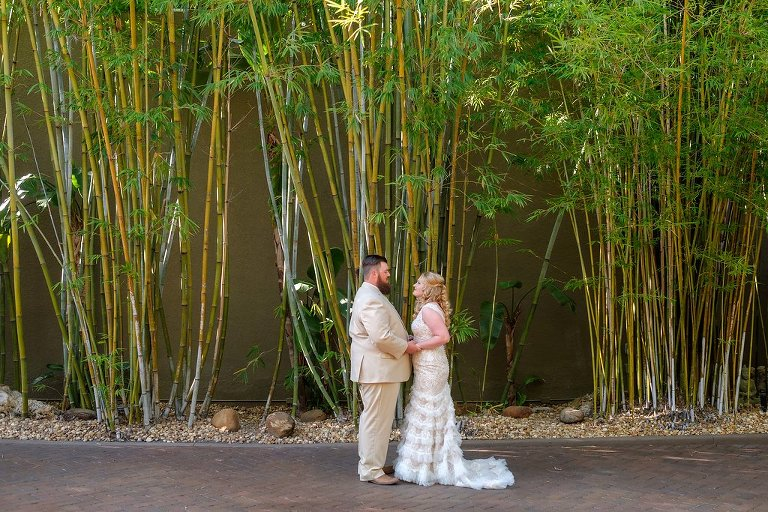 Outdoor Bride and Groom Wedding Portrait, Bride in Fit and Flare Lace and Ruffle Skirt Wedding Dress with Tank Top Straps and Plunging V-Neckline, Groom in Tan Suit | St. Pete Photographer Marc Edwards Photography | Downtown St. Pete Wedding Venue NOVA 535