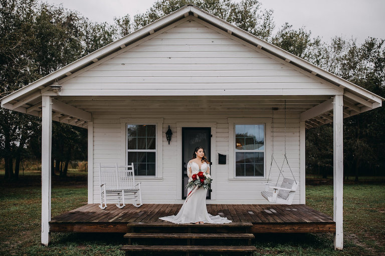 Outdoor Bride Wedding Portrait, Bride in White Lace Long Sleeve David's Bridal Wedding Dress, and Red, White and Greenery Bouquet | Tampa Bay Wedding Photographer Rad Red Creative | Lithia Rustic Wedding Venue Southern Grace