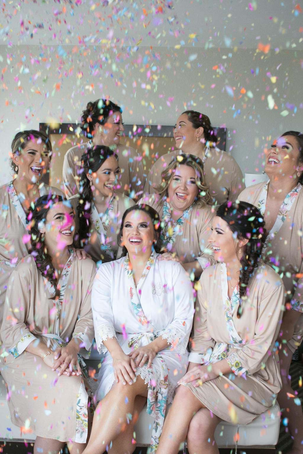 Bridal Party Getting Ready Wedding Portrait with Confetti Toss in Matching Mauve Silk Robes   Tampa Bay Wedding Photographer Carrie Wildes Photography