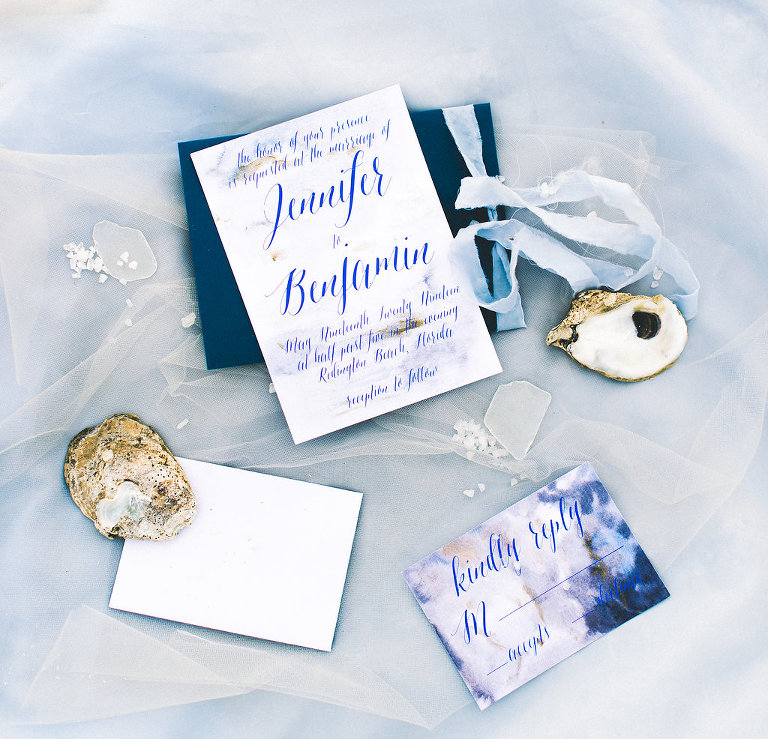 Blue Coastal Watercolor Invitation Suite with Light Blue Ribbon and Oyster Shells