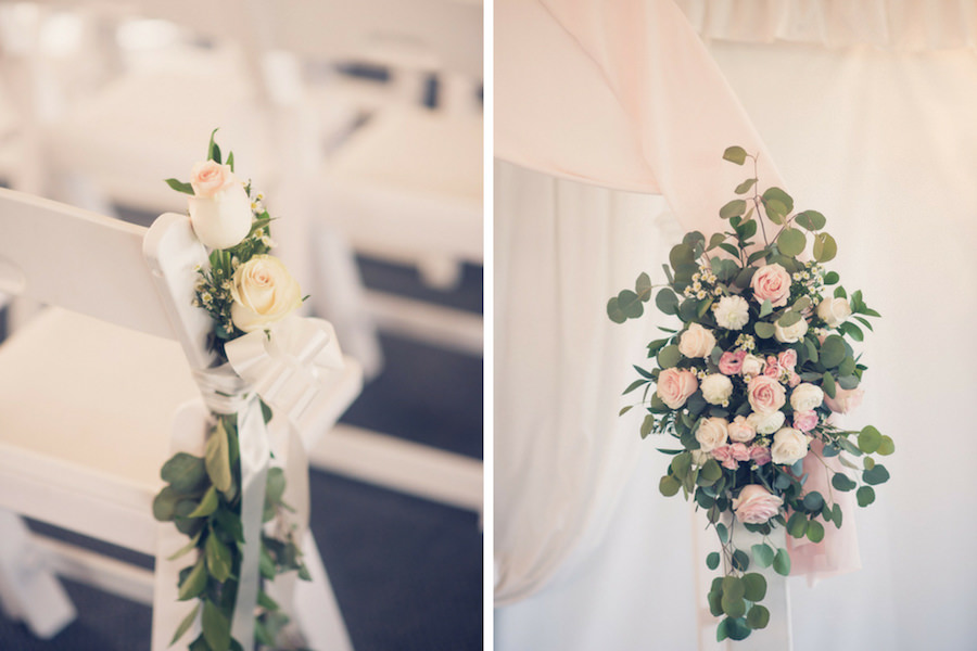 Tampa Bay Wedding Venue Safety Harbor Ceremony Decor, White Folding Chairs with Blush Pink Roses and Greenery Flowers, White and Blush Pink Drapery with Roses and Greenery Bouquet   Tampa Bay Wedding Photographer Luxe Light Photography