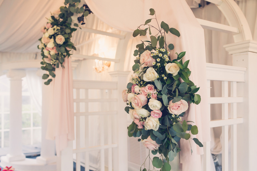 Tampa Wedding Venue Safety Harbor Ceremony Decor, White and Blush Pink Drapery with Blush Pink and Ivory Roses and Greenery Flowers   Tampa Bay Wedding Photographer Luxe Light Photography