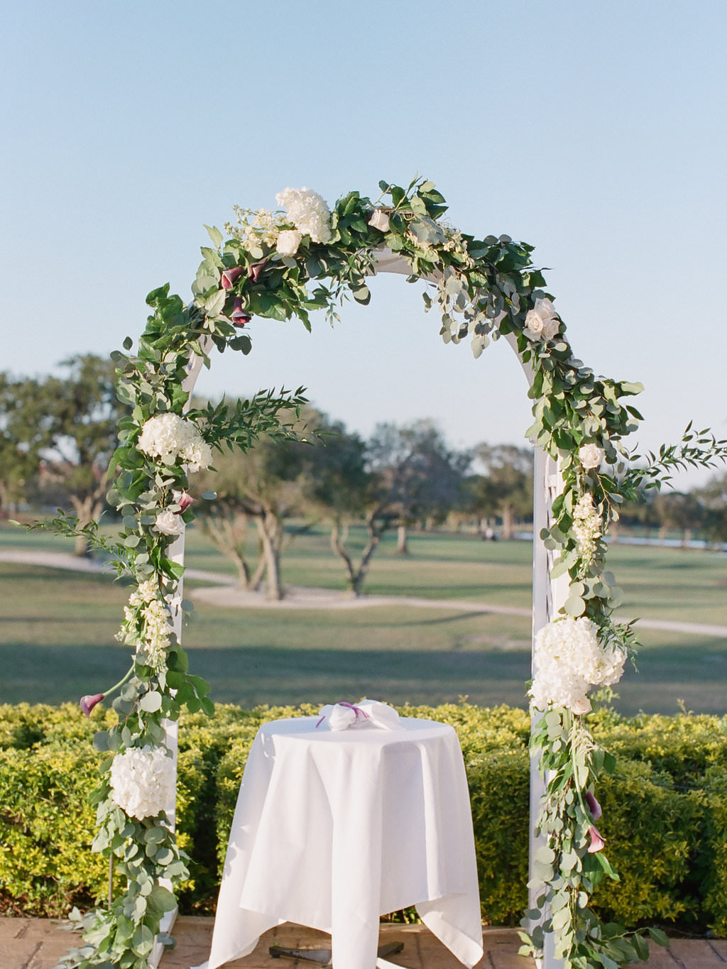 Organic Greenery, White Hydrangeas, and White Flower Inspired Ceremony Arch Chuppah Decor for Outdoor Wedding   Clearwater Wedding Venue Feather Sound Country Club Wedding