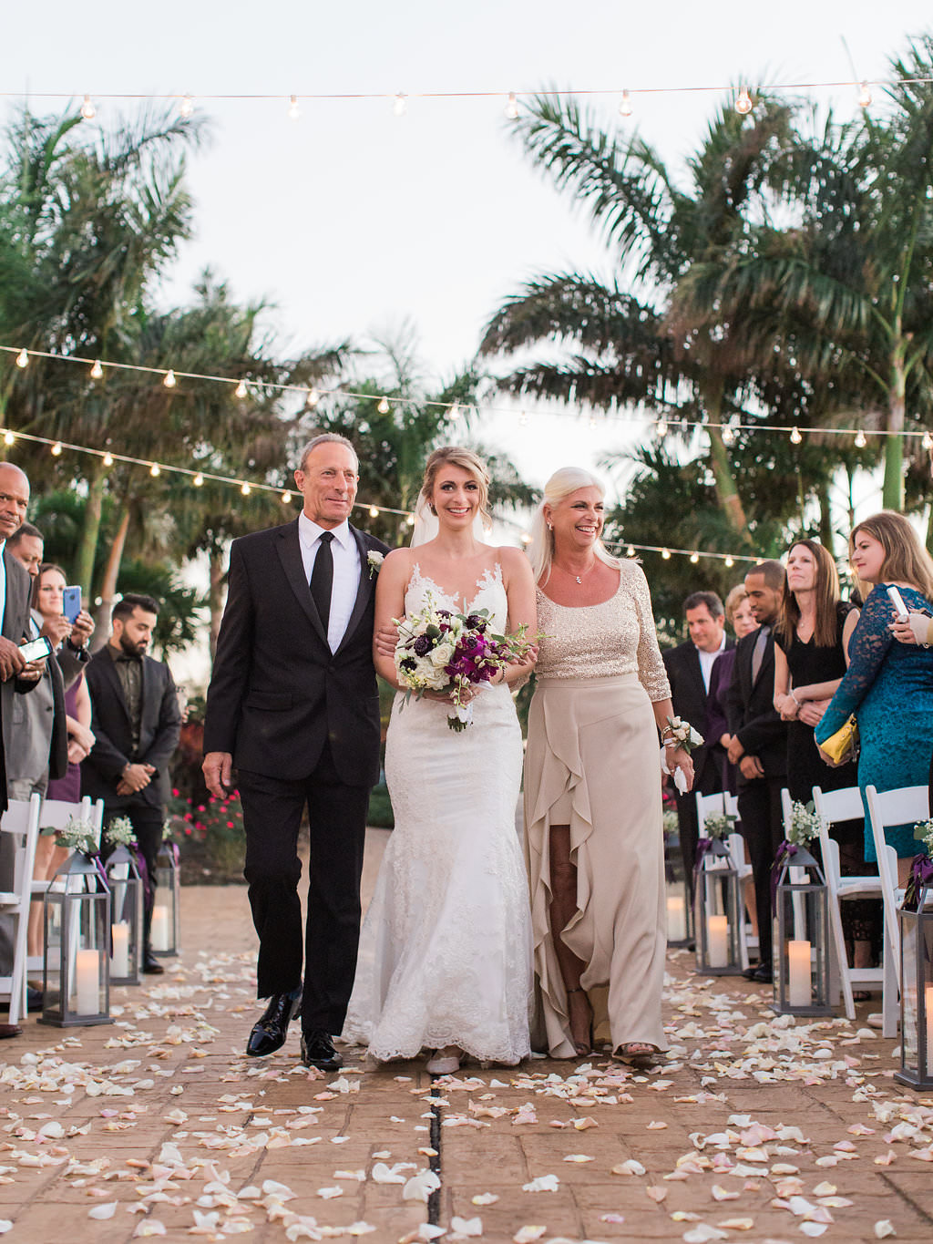 Bride Walking Down the Aisle with Father and Mother Ceremony Portrait, with White Rose, Pink, Deep Purple Flowers and Greenery Bouquet   Clearwater Wedding Venue Feather Sound Country Club