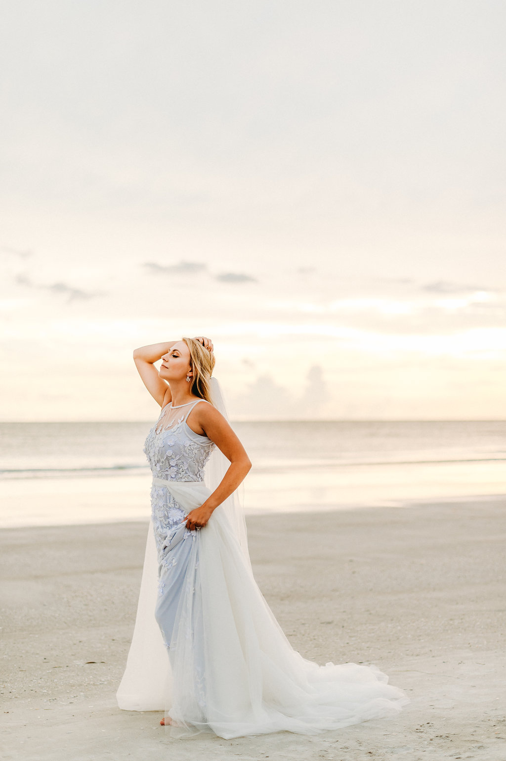 Waterfront, Redington Beach Wedding Bridal Portrait, Bride in Sleeveless Illusion Neckline Floral Overlay and Light Blue Wedding Dress with Tulle Skirt and Veil