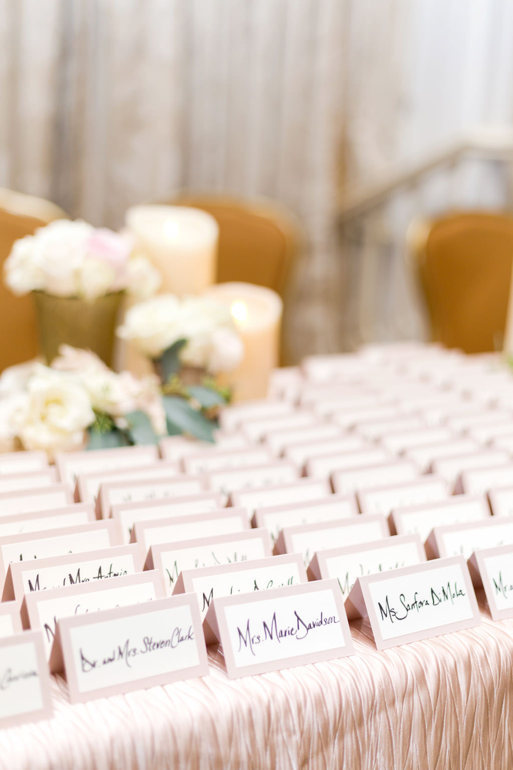 Traditional Wedding Name Escort Place Cards on White and Blush Pink Cardstock with Black Calligraphy Text
