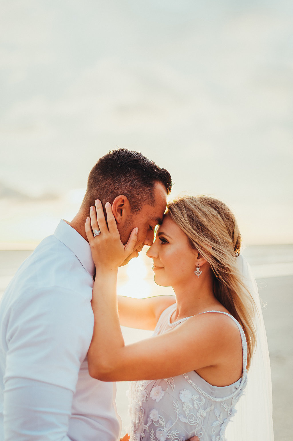 Coastal, Redington Beach Waterfront Sunset Bride and Groom Wedding Portrait, Bride in Sleeveless Illusion Neckline Floral Overlay and Light Blue Wedding Dress with Tulle Skirt and Veil
