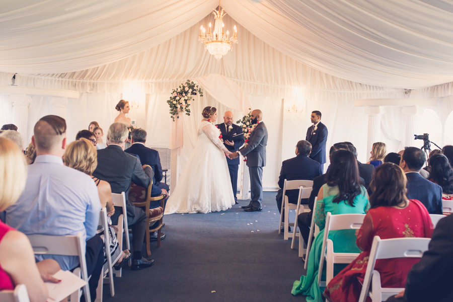 Tampa Wedding Venue Safety Harbor Bride and Groom Ceremony Portrait, White and Blush Linen Drapery, Chandelier and Pink, White and Greenery Floral Bouquet   Tampa Wedding Photographer Luxe Light Photography