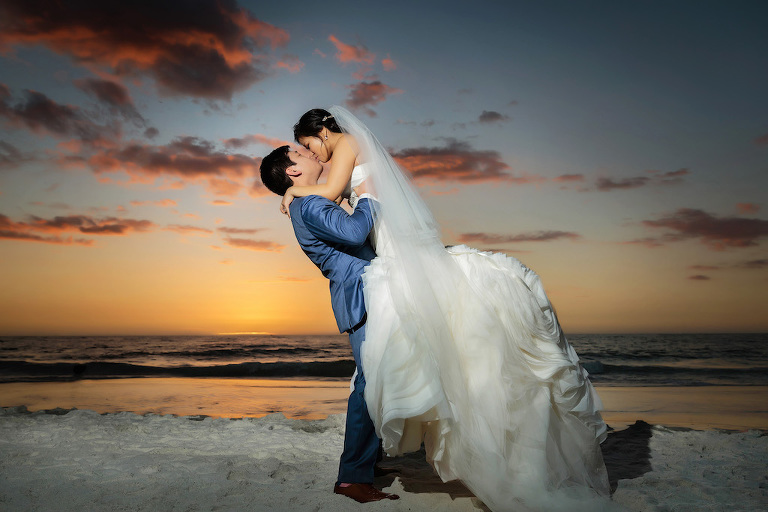 Romantic Outdoor Beach Sunset Bride and Groom Wedding Portrait, Bride in White Trumpet Organza Wedding Dress and Veil, Groom in Blue Suit | Luxury Wedding Venue Hyatt Regency Clearwater Beach