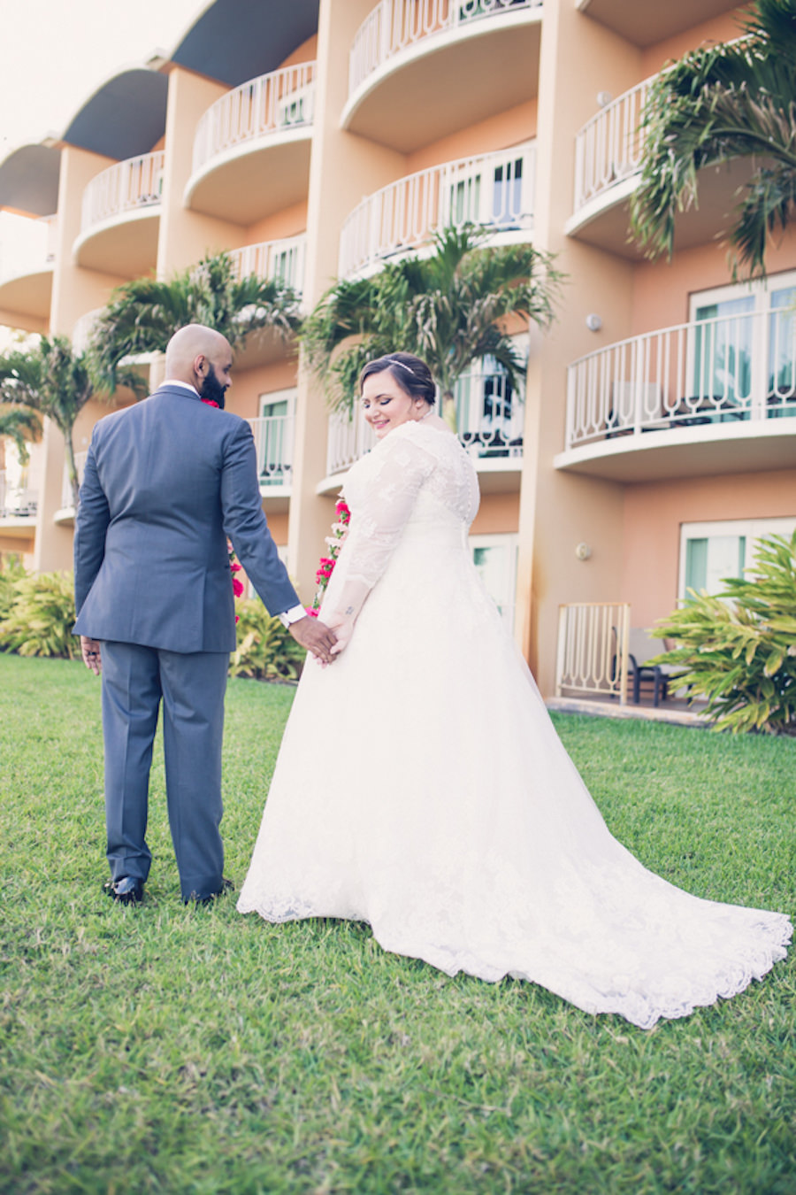 Outdoor Bride and Groom Portrait, Long Sleeve Illusion, V-Neck Lace and Rhinestone Floral Accent Wedding Dress, Groom in Grey Suit with Rose Boutonniere   Tampa Bay Wedding Photographer Luxe Light Photography