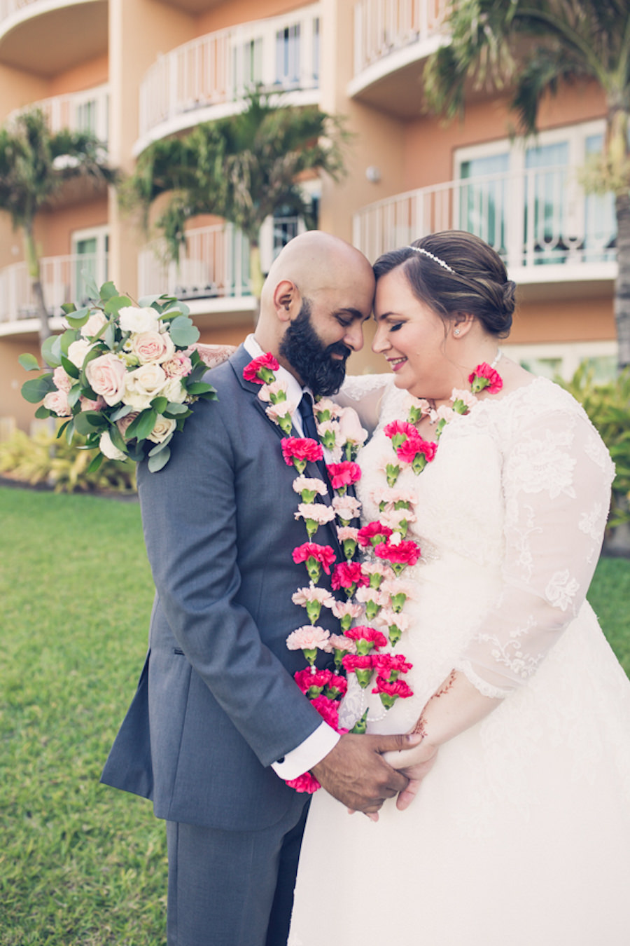 Outdoor Bride and Groom Intimate Wedding Portrait Wearing Pink Floral Leis | Tampa Bay Wedding Photographer Luxe Light Photography