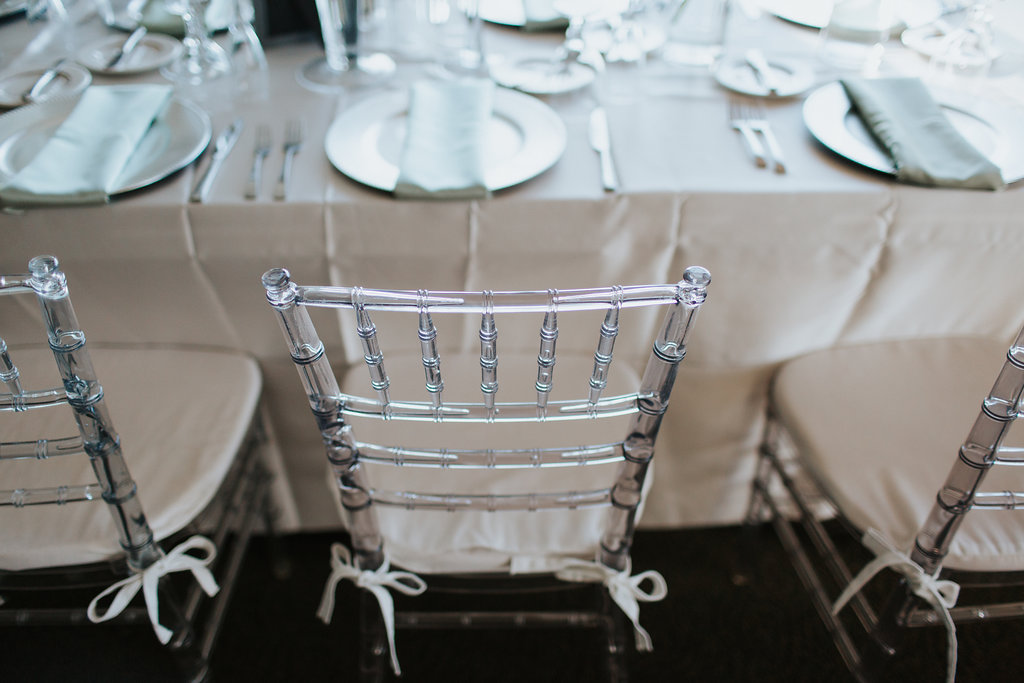 Ballroom Wedding Reception Decor, Clear Acrylic Chairs with White Satin Cushions, Satin White Tablecloth, Silver Plate Chargers and Green Linens   St. Petersburg Wedding Rentals Gabro Event Rentals and Over the Top Linen Rentals
