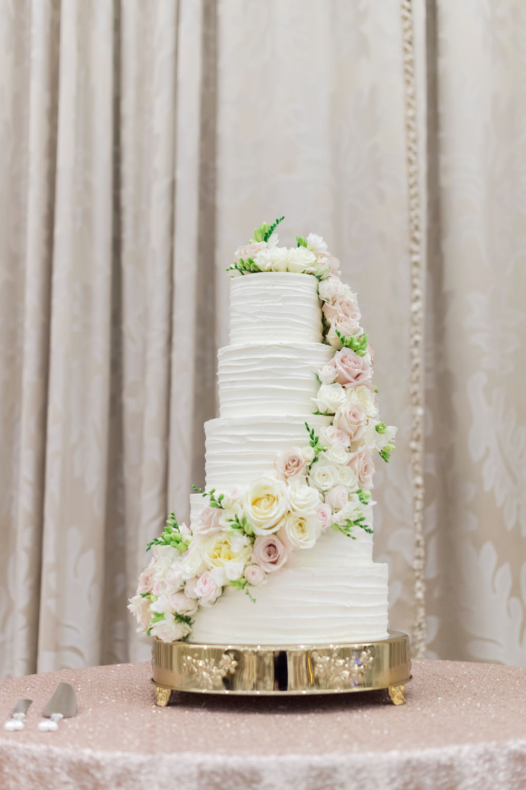 Five Tier White Ruffled Buttercream Wedding Cake With Cascading