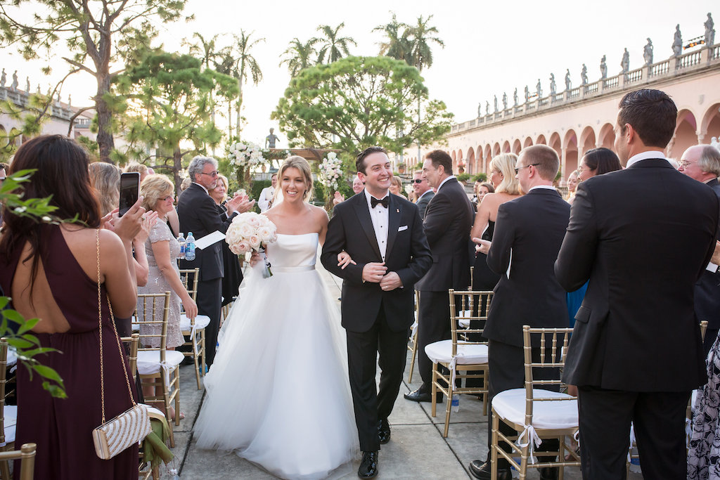 Bride and Groom Recessional Reaction at Wedding Ceremony Portrait | Sarasota Wedding Photographer Cat Pennenga Photography