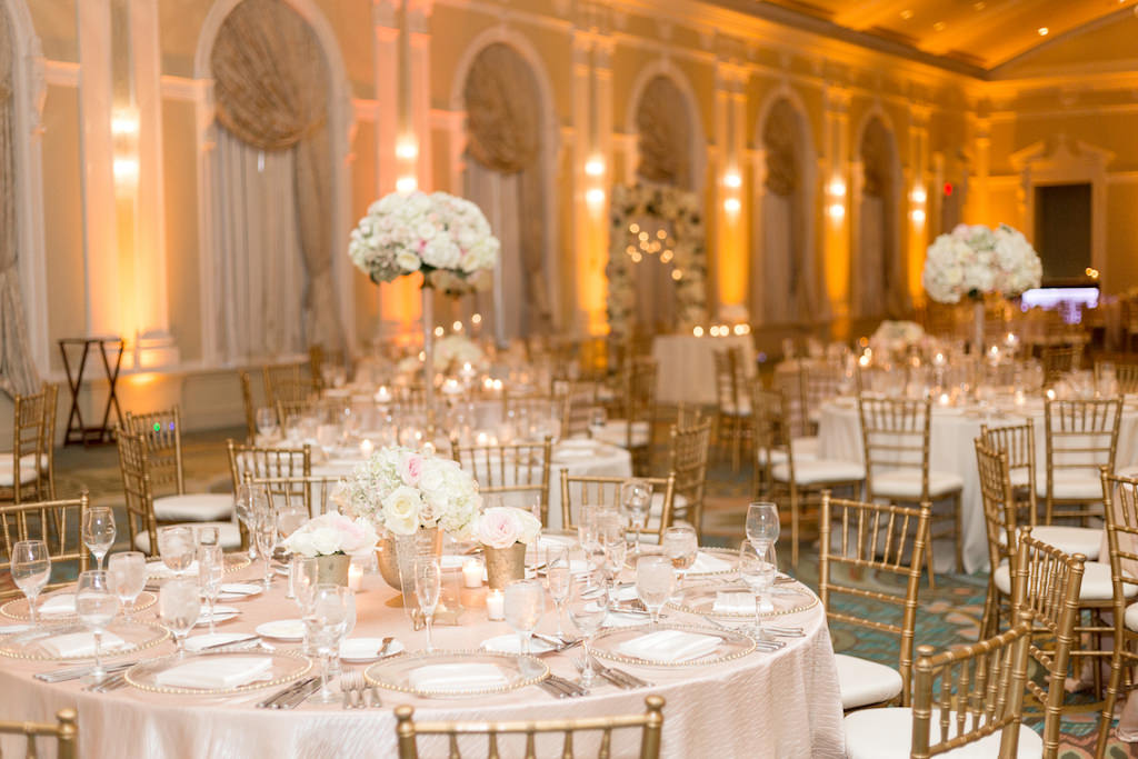 Ballroom Wedding Reception Decor with Round Tables, Gold Chiavari Chairs, Tall and Small White and Blush Pink Floral Centerpieces, Blush Pink Satin Table Linens | St. Petersburg Wedding Venue The Vinoy Renaissance