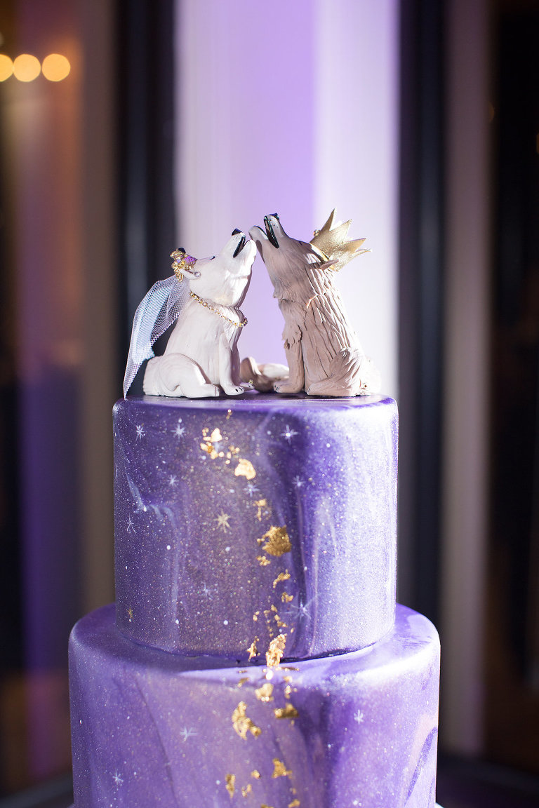 Four Tier Marble Ombre Enchanted Magical Purple and Champagne Cake and Amethyst Geode, Gold Leafing Painted Cascading Stars and Shimmer Airbrushing with Custom Wolf and Fox Cake Topper on Acrylic Cake Stand and Gold Votive Candle Holders on Champagne Tablecloth | Clearwater Beach Wedding Venue Feather Sound Country Club | St. Petersburg Wedding Baker The Artistic Whisk