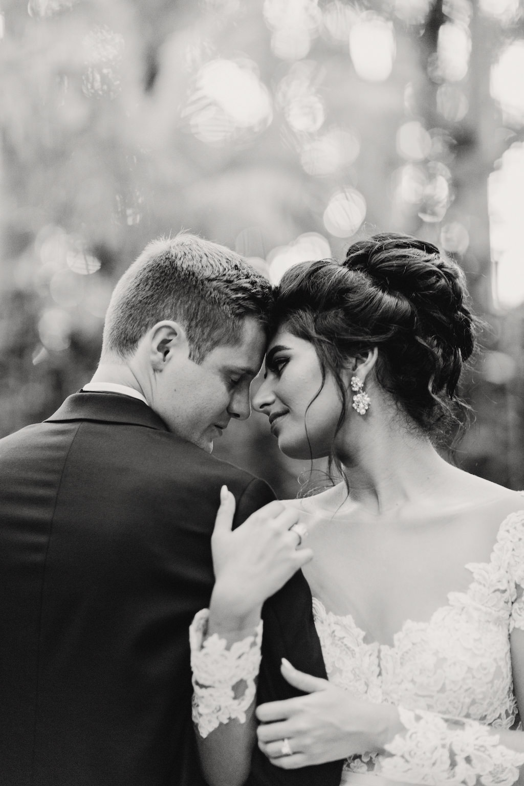 Intimate Bride and Groom Outdoor Wedding Portrait, Bride in A-Line Long Sleeve Illusion and Lace Wedding Dress, Groom in Black Tuxedo   St. Petersburg Venue The Sunken Gardens