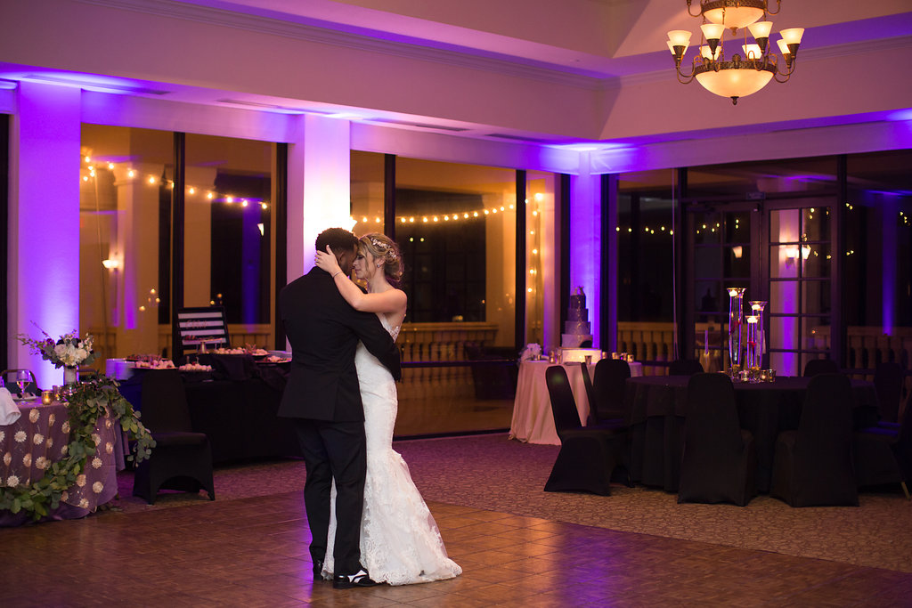 Indoor Ballroom Wedding Reception Bride and Groom Dancing with String Lighting   Clearwater Wedding Venue Feather Sound Country Club