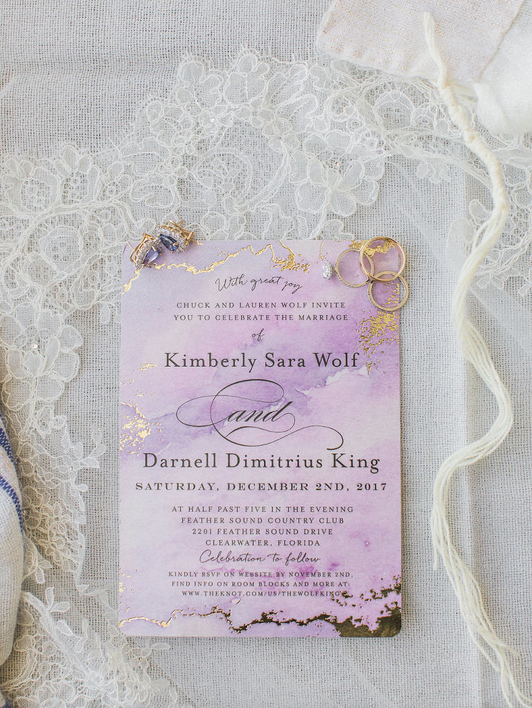 Purple Watercolor and Gold Foil Marble Wedding Invitation with Gold Engagement and Wedding Rings, Purple Diamond Earrings on White Lace