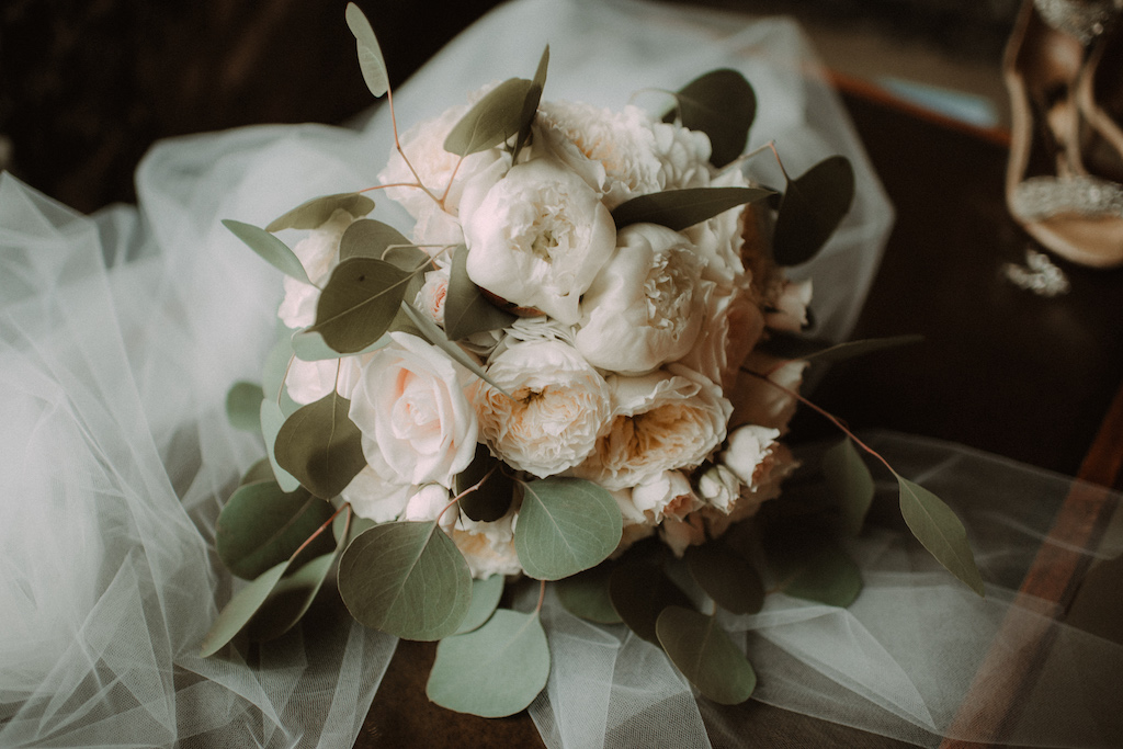 Ivory Peonies and Roses and Silver Dollar Eucalyptus Wedding Bouquet Wrapped in Tulle