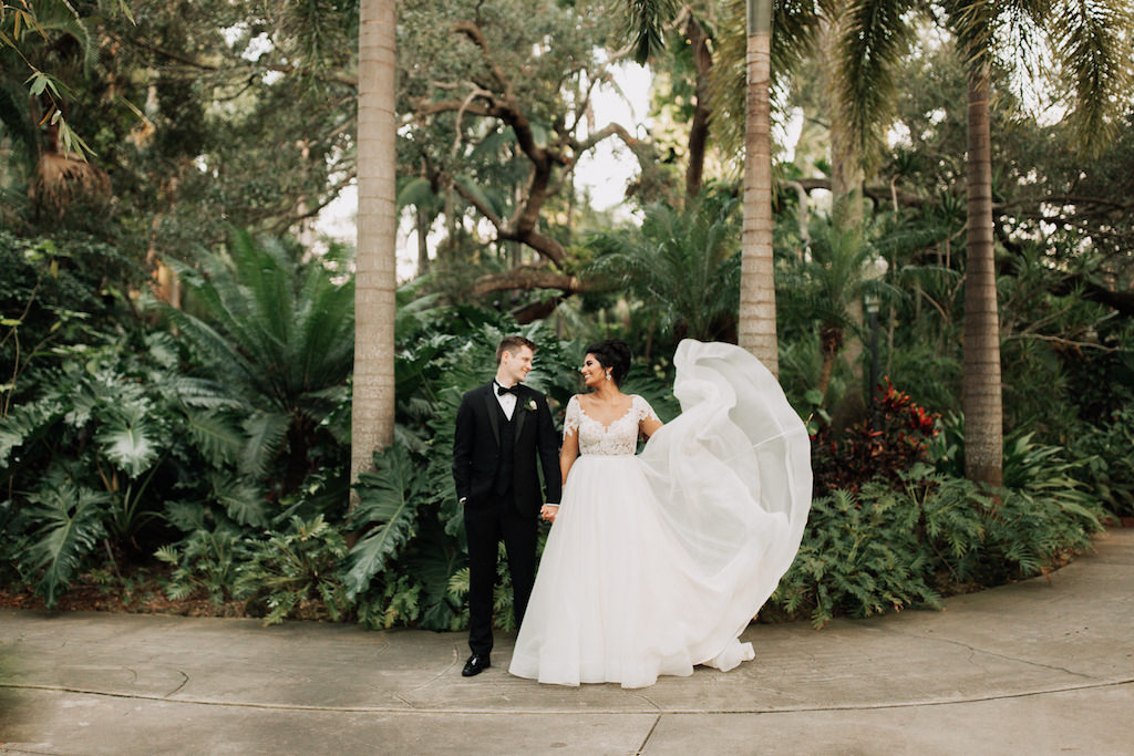 Bride and Groom Outdoor Wedding Portrait, Bride in A-Line Long Sleeve Illusion and Lace Paloma Blanca Wedding Dress, Groom in Black Tuxedo   St. Petersburg Venue The Sunken Gardens