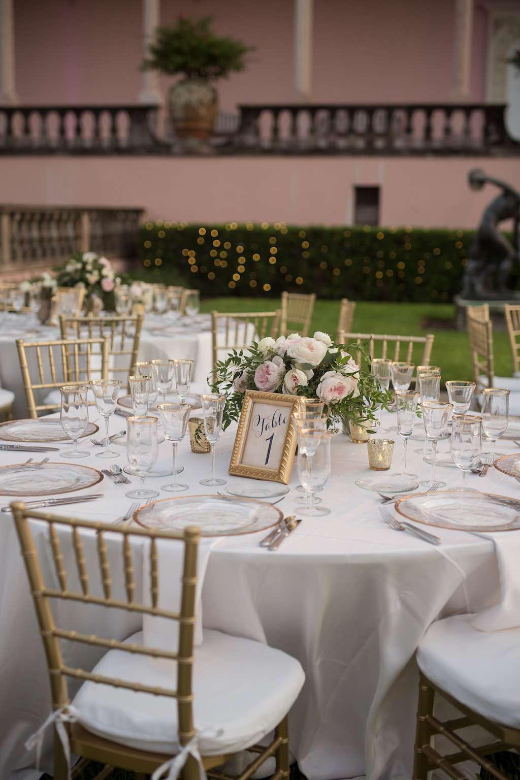 Elegant White Outdoor Garden Wedding with White Linens and Gold Table Number with Low Blush Pink Centerpieces