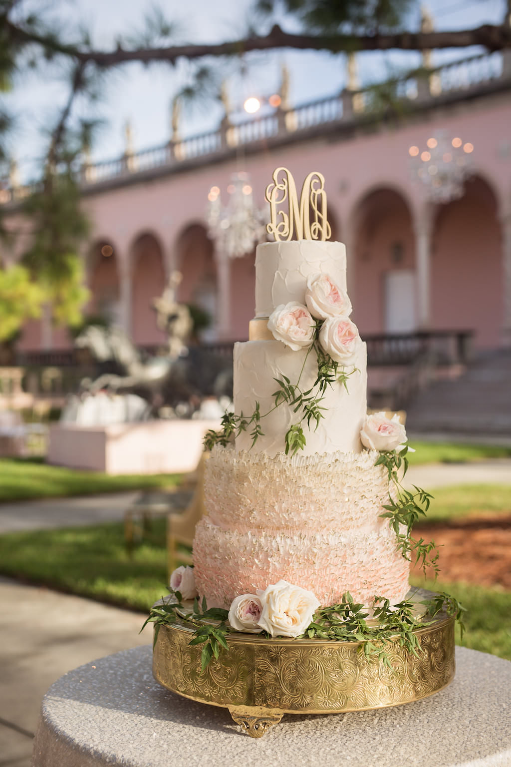 Four Tier Round Blush Pink and White Ombre Ruffled Wedding Cake with Gold Monogram Initial Topper