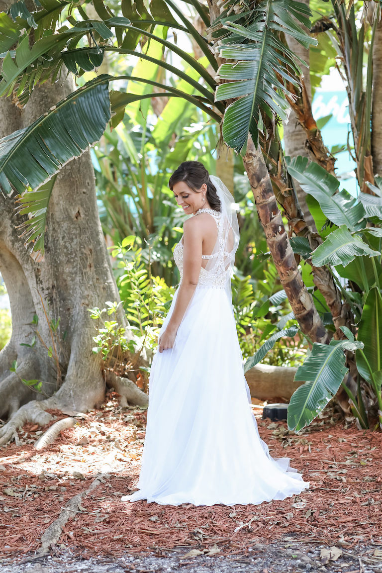 Outdoor Bridal Portrait A-Line Scoop Neck Nude Rhinestone Bodice and White Chiffon Floor Length Wedding Dress with Beaded Keyhole Back and Veil and Half Up Hairdo | Tampa Bay Wedding Photographer Lifelong Photography Studios | Tampa Bay Wedding Hair and Makeup Michele Renee the Studio