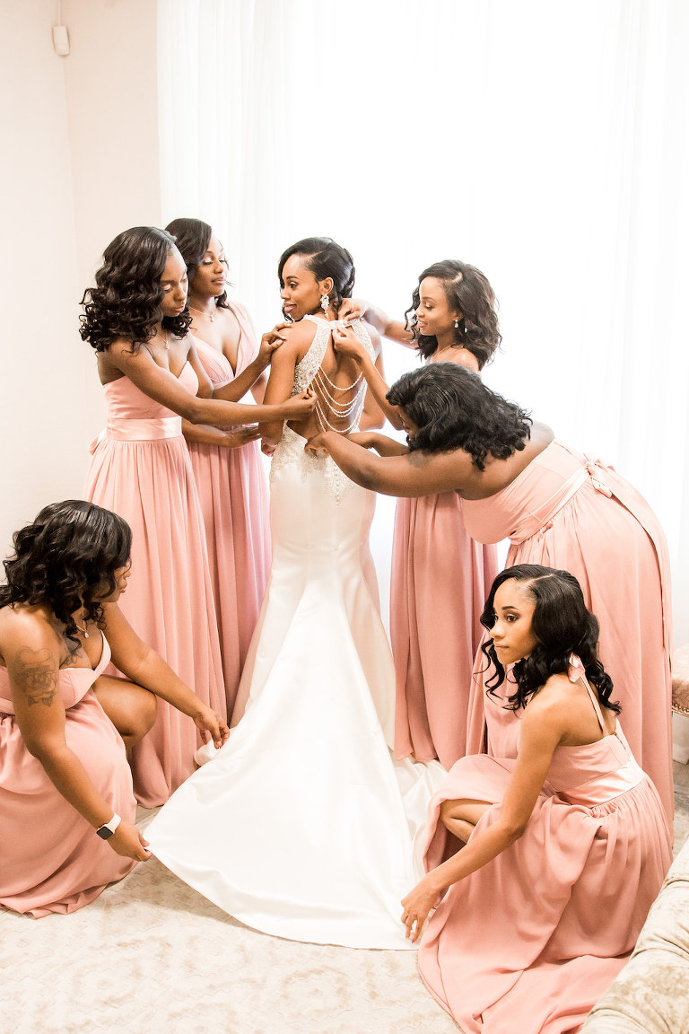 Bride and Bridesmaids Getting Ready Portrait Illusion V-neck Rhinestone Beaded Bodice and Tank Top Strap Wedding Dress with Keyhole Back, Bridesmaids in Blush Pink Mix and Match Dresses | Tampa Wedding Dress Shop Truly Forever Bridal