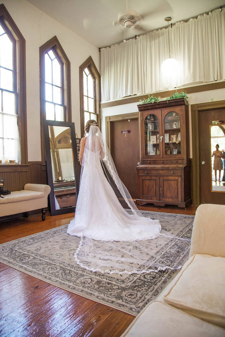 Bride Getting Ready Portrait in White A-Line Strapless Sweetheart Lace Wedding Dress and Cathedral Length Veil