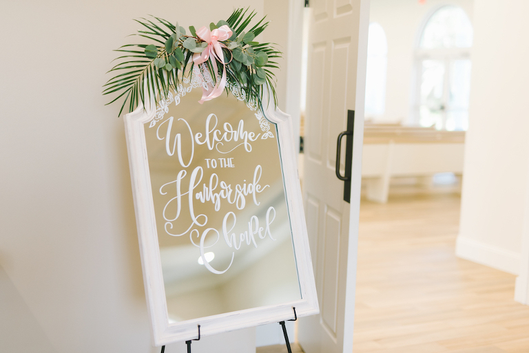 Wedding Ceremony Welcome Sign on White Mirror Greenery | Tampa Bay Wedding Venue Harborside Chapel | Tampa Bay Photographer Kera Photography