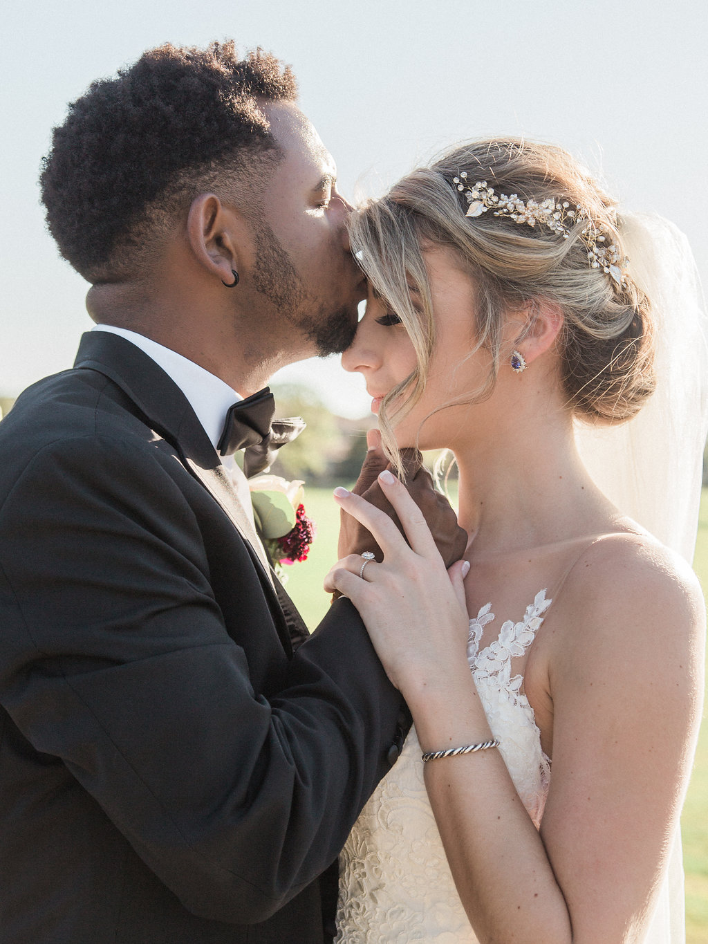 Intimate Outdoor Wedding Portrait, Bride in Spaghetti Strap Lace Dress, Curled Hair Updo with Floral Headpiece and Tulle Veil, Groom in Black Tuxedo with White Rose and Red Flower Boutonniere   Tampa Bay Wedding Hair and Makeup Artist LDM Beauty Group