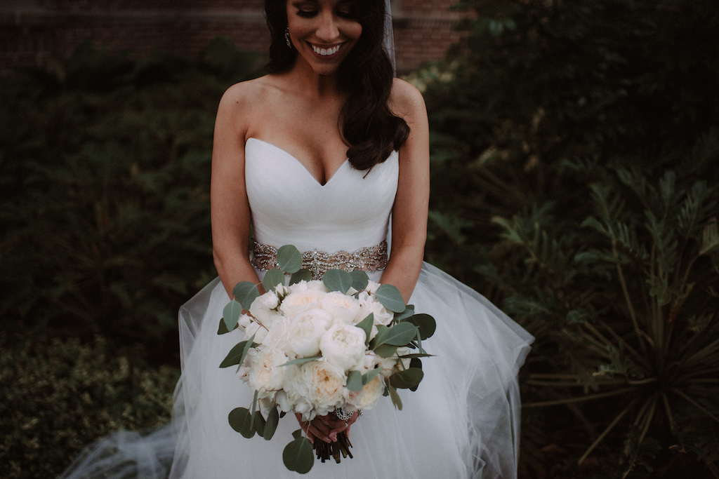 Bride Wedding Portrait Holding Ivory Rose, Peonies and Silver Dollar Eucalyptus Bouquet Wearing White Sweetheart Tulle Skirt Wedding Dress with Rhinestone Belt | Bridal Shop The Bride Tampa