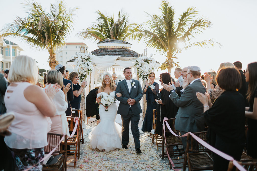 Outdoor Beach Wedding Ceremony Exit Bride and Groom at Gazebo with Birchwood Arch, White Draping and White Florals   Waterfront Venue Isla Del Sol Yacht and Country Club