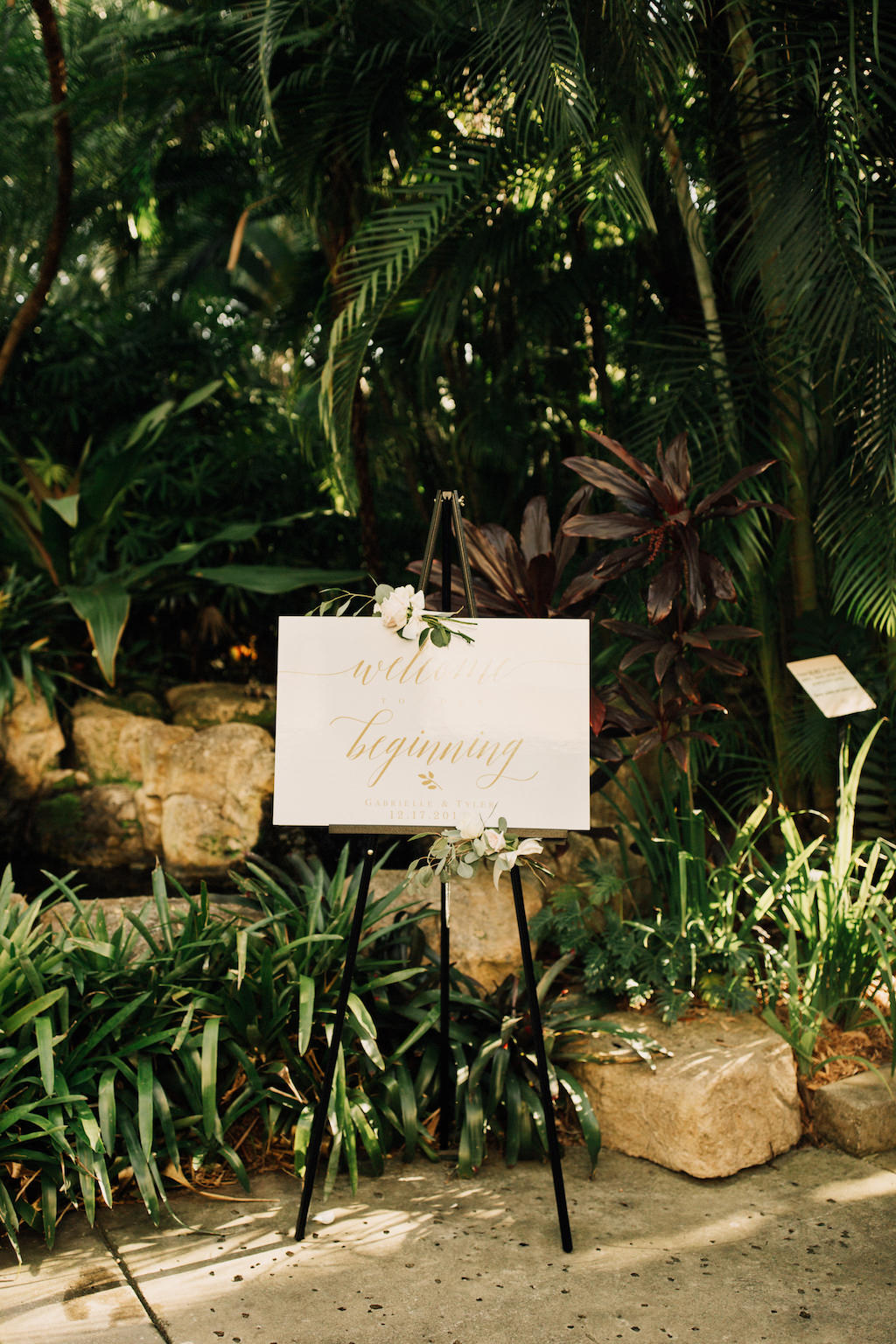 Gold Cursive Script Outdoor Garden Wedding Ceremony Welcome Sign with Roses and Greenery