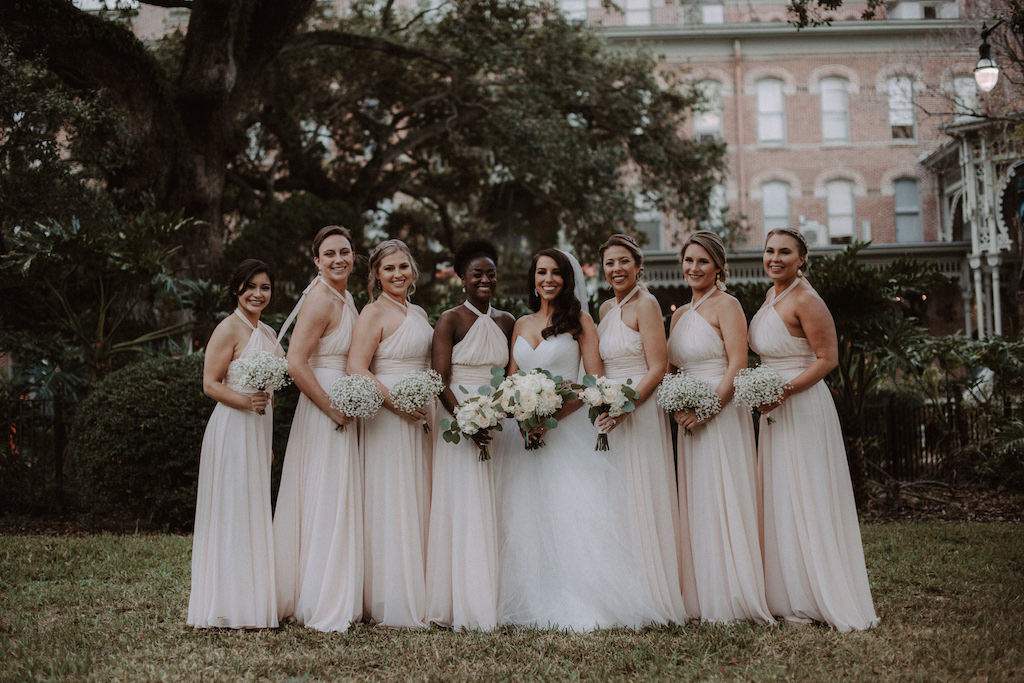 Outdoor Bride and Bridesmaids Wedding Portrait, Bride Holding Ivory Rose, Peonis and Silver Dollar Eucalyptus Bouquet Wearing White Sweetheart Tulle Skirt Wedding Dress with Rhinestone Belt, Bridesmaids in Floor Length Blush Dresses with Baby's Breath | Tampa Bay Location The University of Tampa
