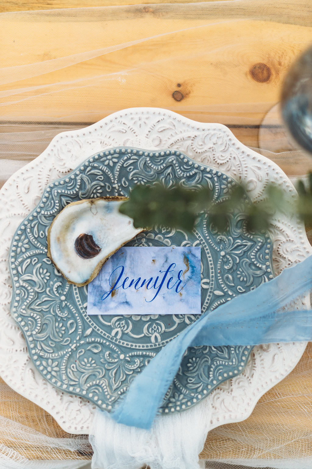 Coastal Beach Redington Shores Wedding Reception Decor, Dusty Blue Textured Plate on Ivory Textured Plate, Custom Watercolor Blue Script Place Card with Oyster Shell and Blue Tulle Ribbon
