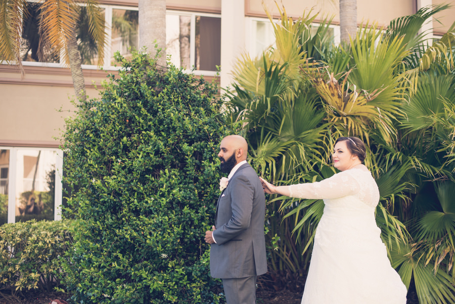 Outdoor Bride and Groom First Look Portrait, Long Sleeve Illusion, V-Neck Lace and Rhinestone Floral Accent Wedding Dress, Groom in Grey Suit with Rose Boutonniere   Tampa Bay Wedding Photographer Luxe Light Photography