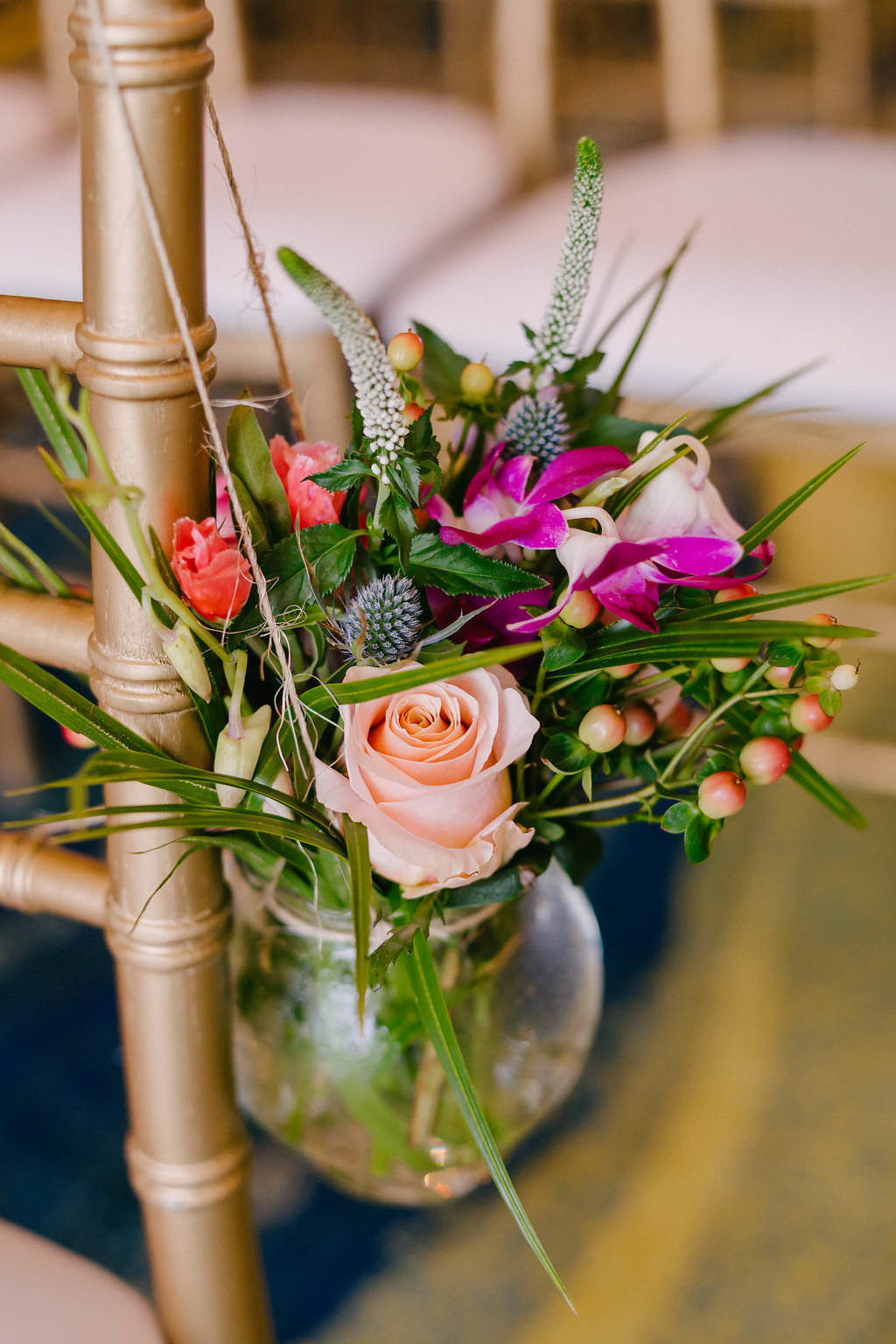 Tropical Inspired Wedding Ceremony Decor, Pink Rose, Purple Orchid, Berries and Greenery Bouquet in Glass Vase Hanging from Gold Chiavari Chair | Tampa Bay Wedding Photographer Grind and Press | Special Moments Event Planning