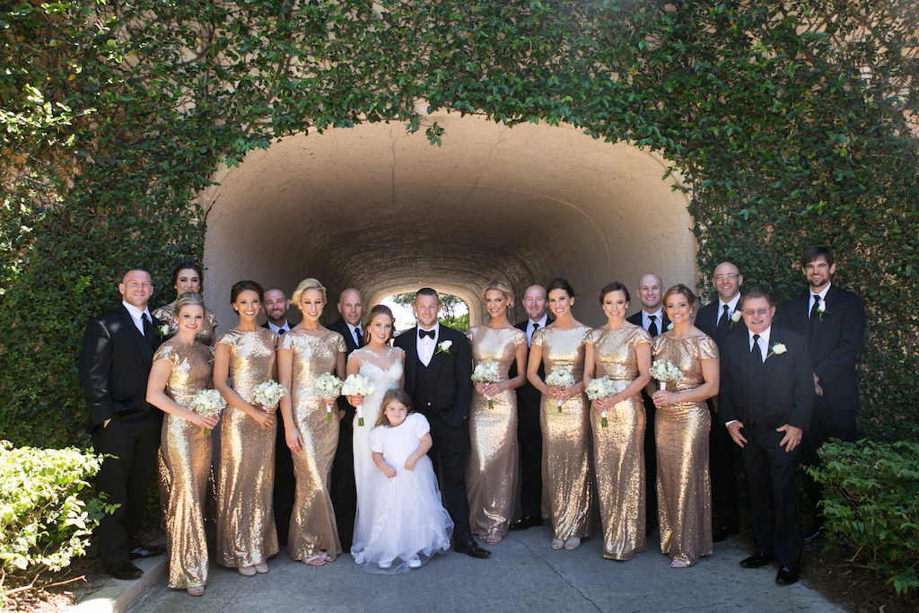 Outdoor Elegant Wedding Party Portrait Groom And Groomsmen In Black Tuxedos Bridesmaids Matching Long Gold Sequin Dresses Bride Maggie Sottero