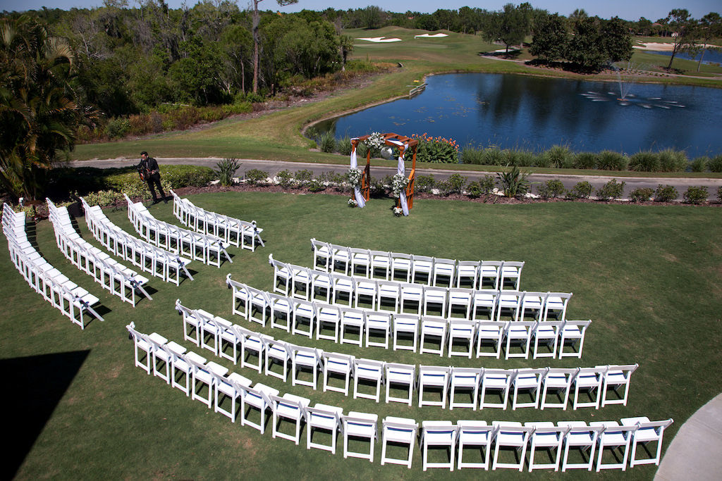 Outdoor Lawn Ceremony with Curved Semi Circle Seating Arrangement Lakewood Ranch Golf and Country Club Wedding Ceremony | Sarasota Wedding Photographer Carrie Wildes Photography
