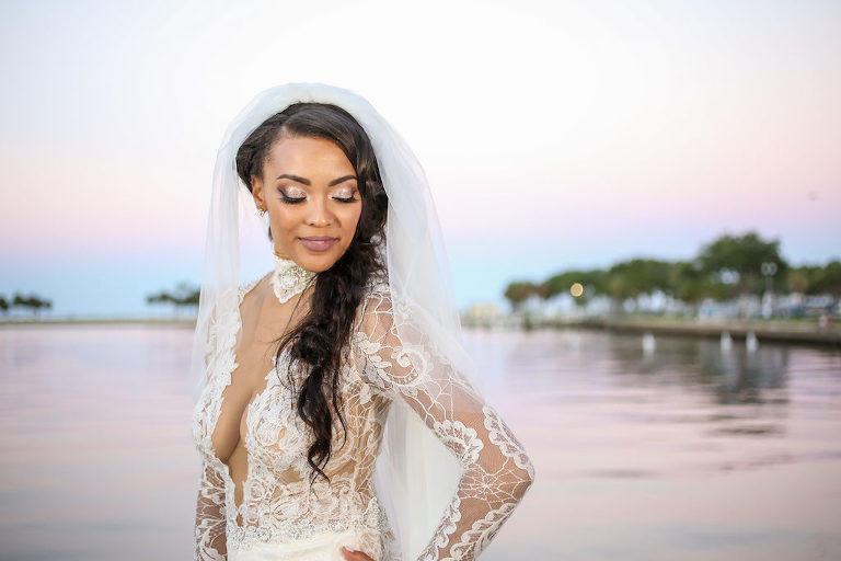 Outside Bridal Portrait, Lace and Sheer Long Sleeve Low V-Neck Wedding Dress and Braided Hairstyle with Veil | St. Petersburg Photographer Lifelong Photography Studios