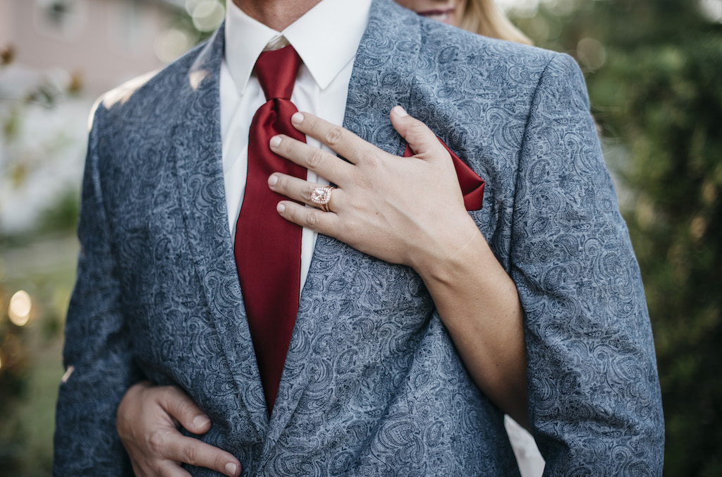 Outdoor Bride and Groom Wedding Portrait, Groom in Blue Paisley Suit with Burgundy Tie and Pocket Square, Bride Rose Gold Engagement Ring | Sarasota Wedding Planner Kelly Kennedy Weddings and Events