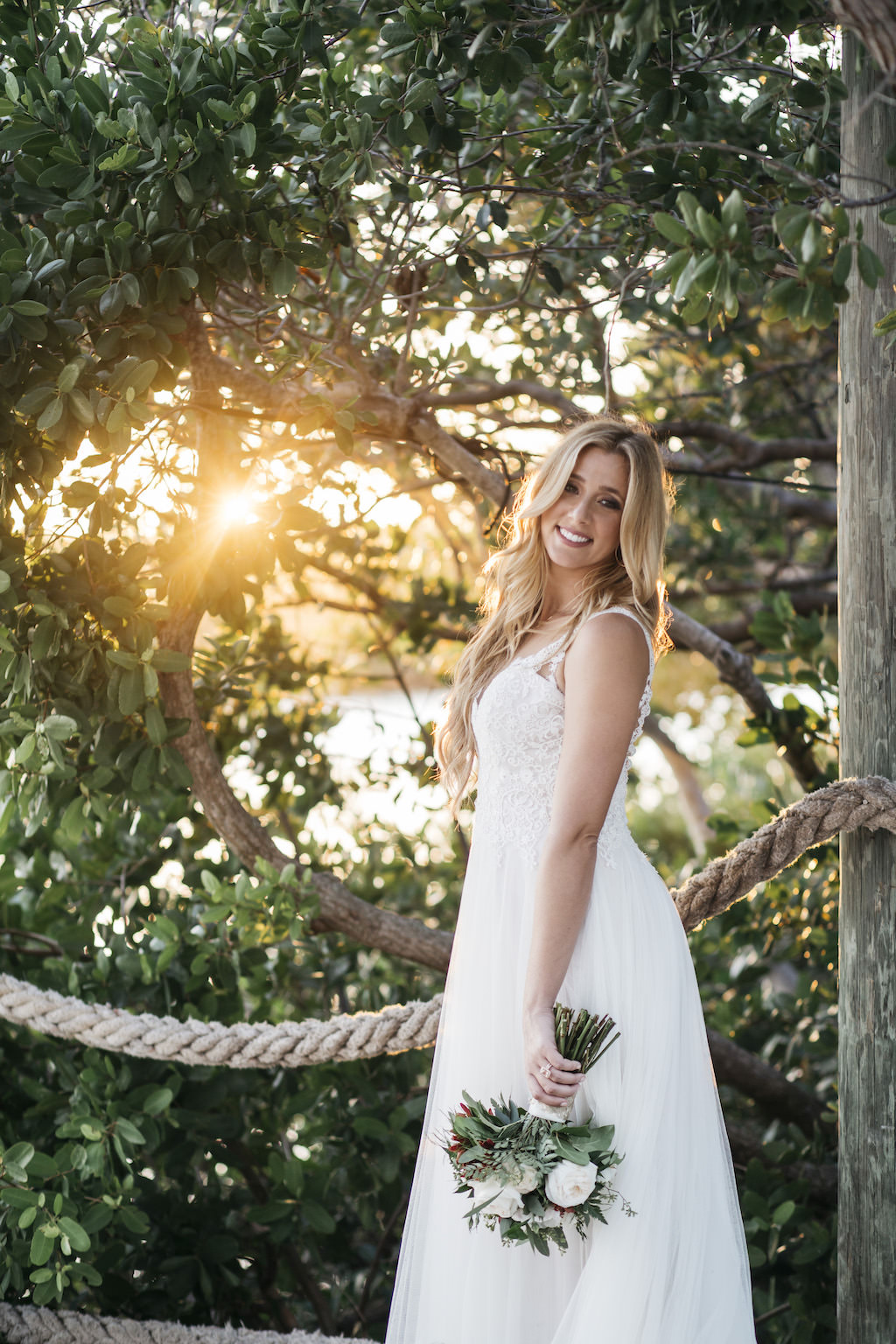Sunset Outdoor Bridal Portrait in Lace Bodice with Lace Straps Empire Waist Wedding Dress with Greenery and Ivory Floral Bouquet