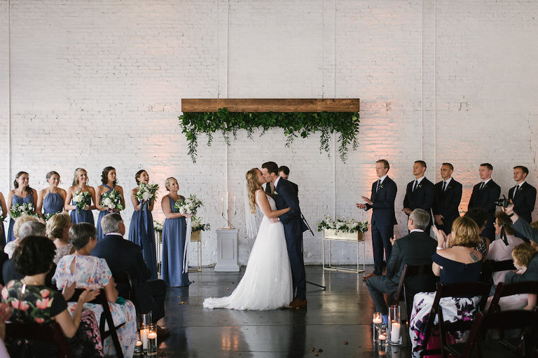Wedding Ceremony Portrait, Groomsmen Wearing Navy Blue Suits, Bridesmaids Wearing Dusty Blue Dresses with White and Greenery Bouquets, Bride Wearing A-Line Wedding Dress   Tampa Wedding Venue Haus 820