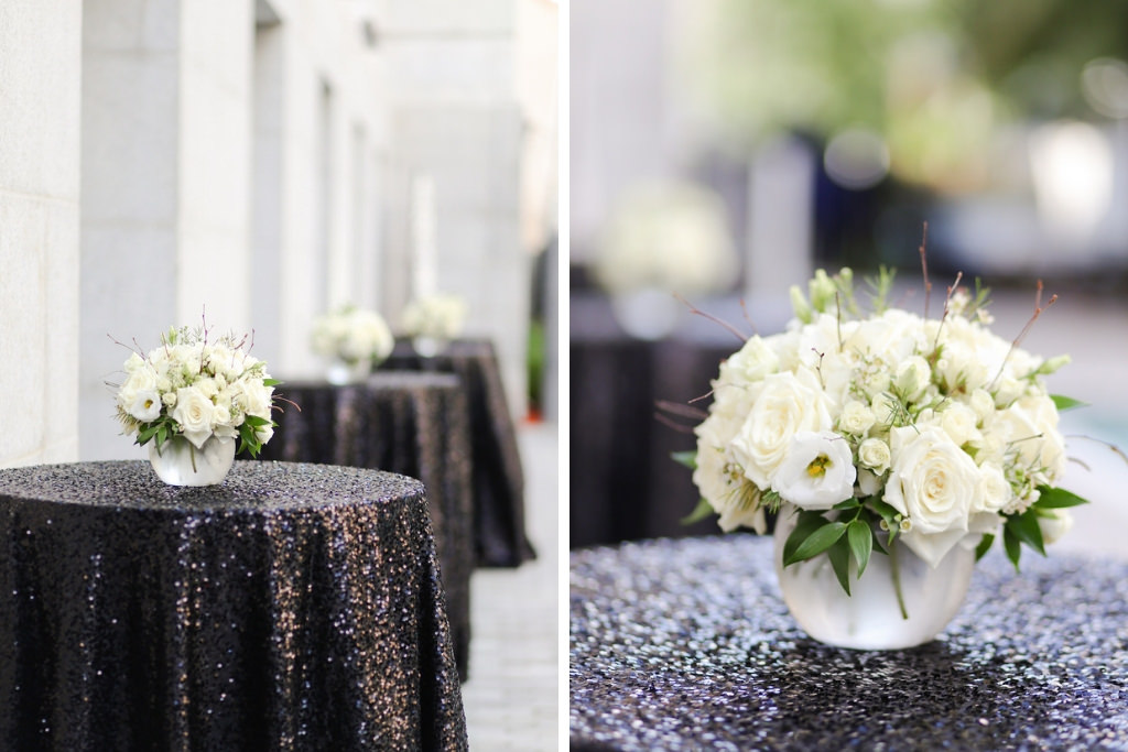 Round High Top Cocktail Table with Small Round Vase and White Rose and Greenery Flowers on Black Sequin Linen   Marry Me Tampa Bay and Isabel O'Neil Bridal Fashion Runway Show 2018   Tampa Wedding Photographer Lifelong Photography Studios   Tampa Bay Rentals Kate Ryan Events   Planner Love Lee Lane