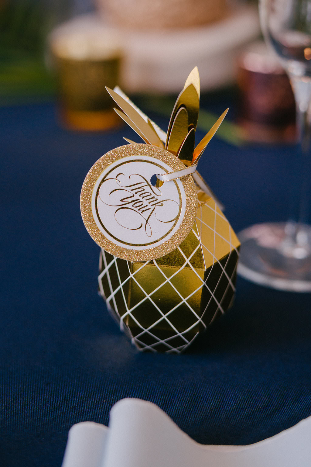 Tropical Inspired Hotel Wedding Reception Decor, Gold Paper Pineapple Wedding Favor on Navy Blue Linen | Tampa Bay Photographer Grind and Press | Special Moments Event Planning