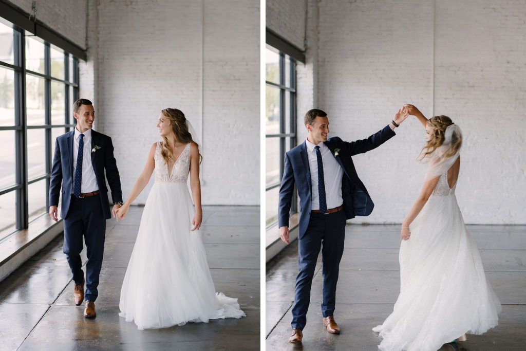 Bride and Groom Dancing Wedding Portrait, Groom in Navy Blue Suit and Watch, Bride in White A-Line Illusion Tank Top Strap Plunging V-Neckline Lace and Beaded Bodice Wedding Dress | Lakeland Wedding Venue Haus 820