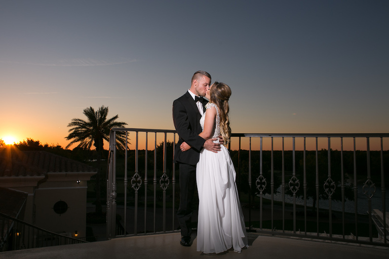 Intimate Sunset Outdoor Bride and Groom Wedding Portrait on Balcony | Sarasota Wedding Photographer Carrie Wildes Photography